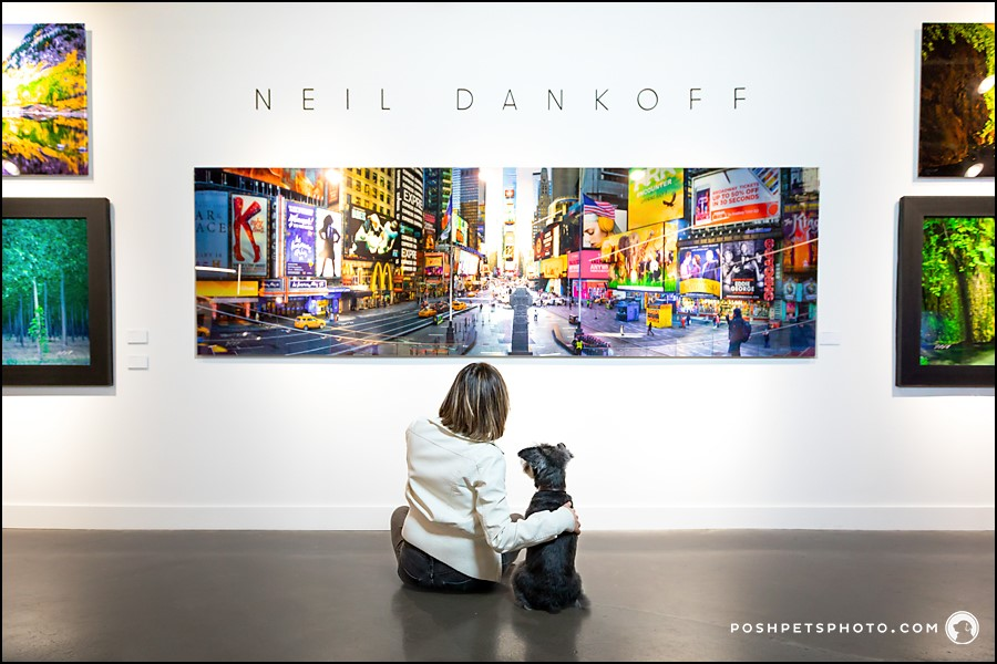 Woman and her dog looking at a photo in the gallery
